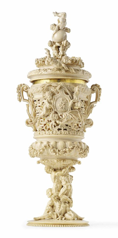 A CARVED IVORY CUP AND COVER