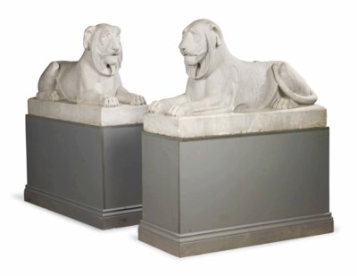 A PAIR OF CARVED MARBLE RECLIN