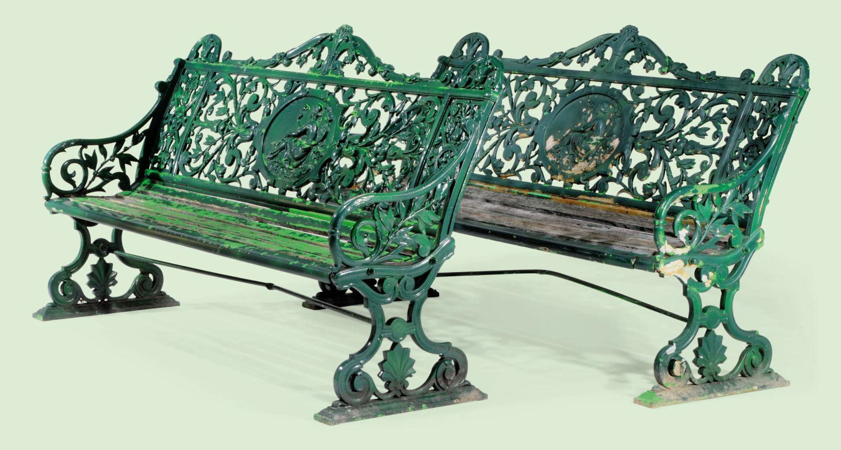TWO LATE VICTORIAN GREEN-PAINTED 'MEDALLION' PATTERN CAST-IRON SEATS