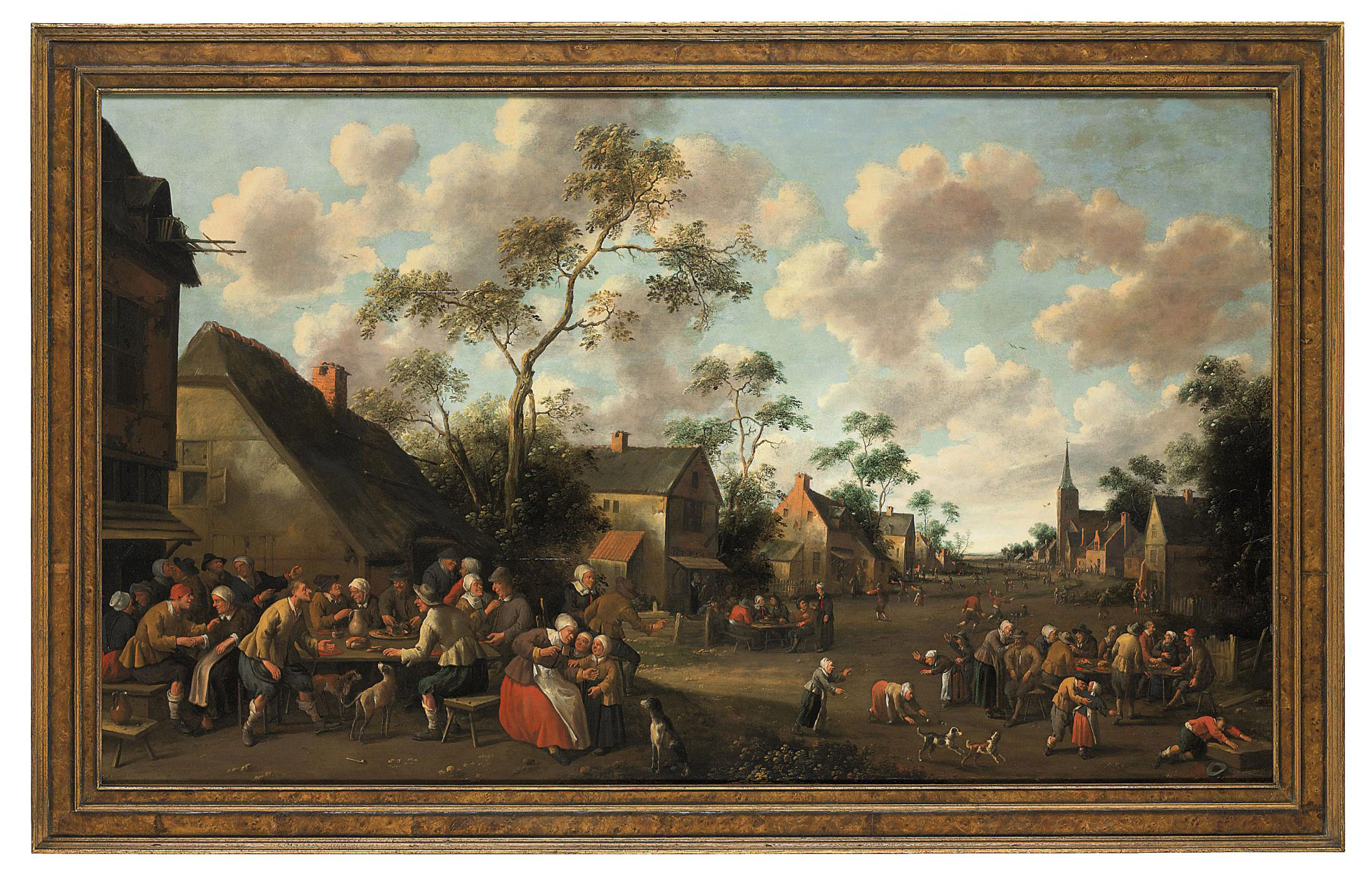 A village feast, with a church and landscape beyond