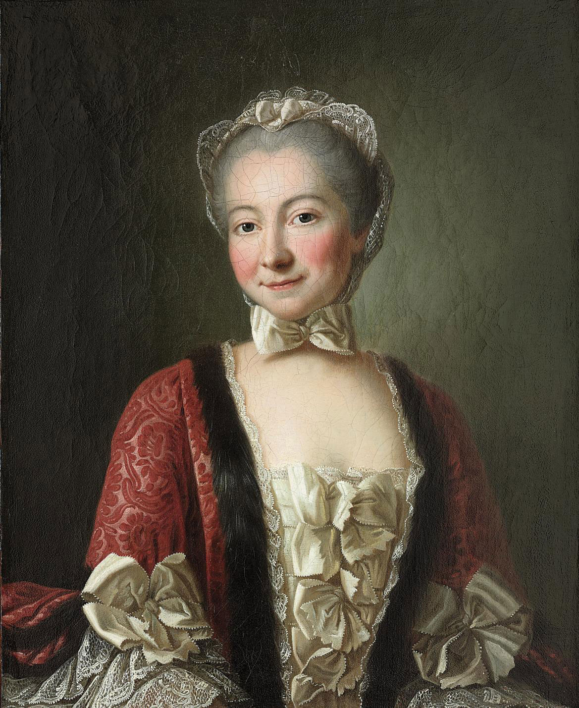 Portrait of a lady, said to be the marquise de Beauharnais, half-length, in a lace gown and fur-lined red coat, with a bonnet