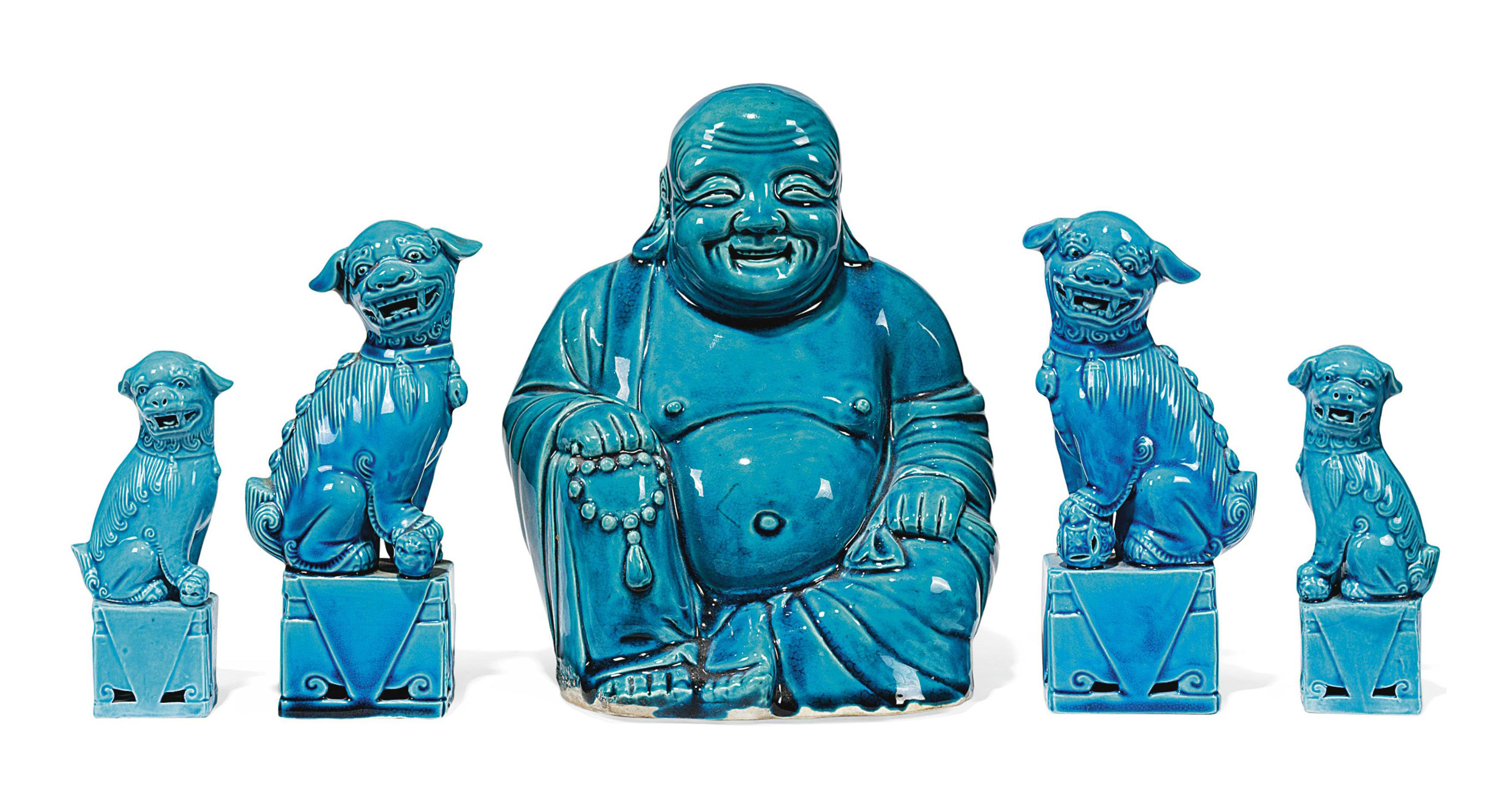 FOUR TURQUOISE-GLAZED MODELS OF BUDDHIST LIONS AND A FIGURE OF BUDAI