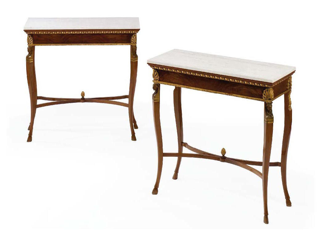 A PAIR OF ITALIAN GILT-BRONZE MOUNTED MAHOGANY AND PARCEL-GILT CONSOLE TABLES