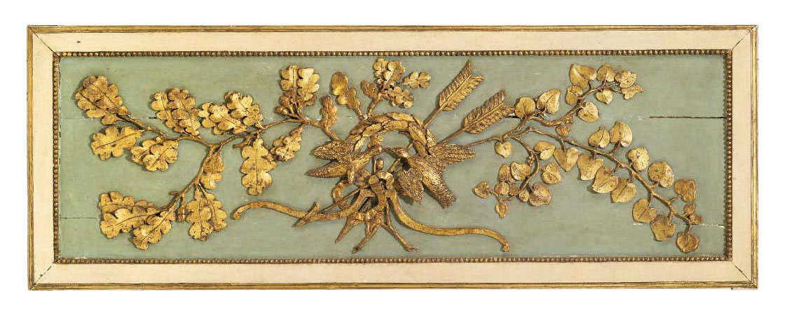 AN ITALIAN PAINTED AND PARCEL-GILT CARVED PANEL FRAGMENT