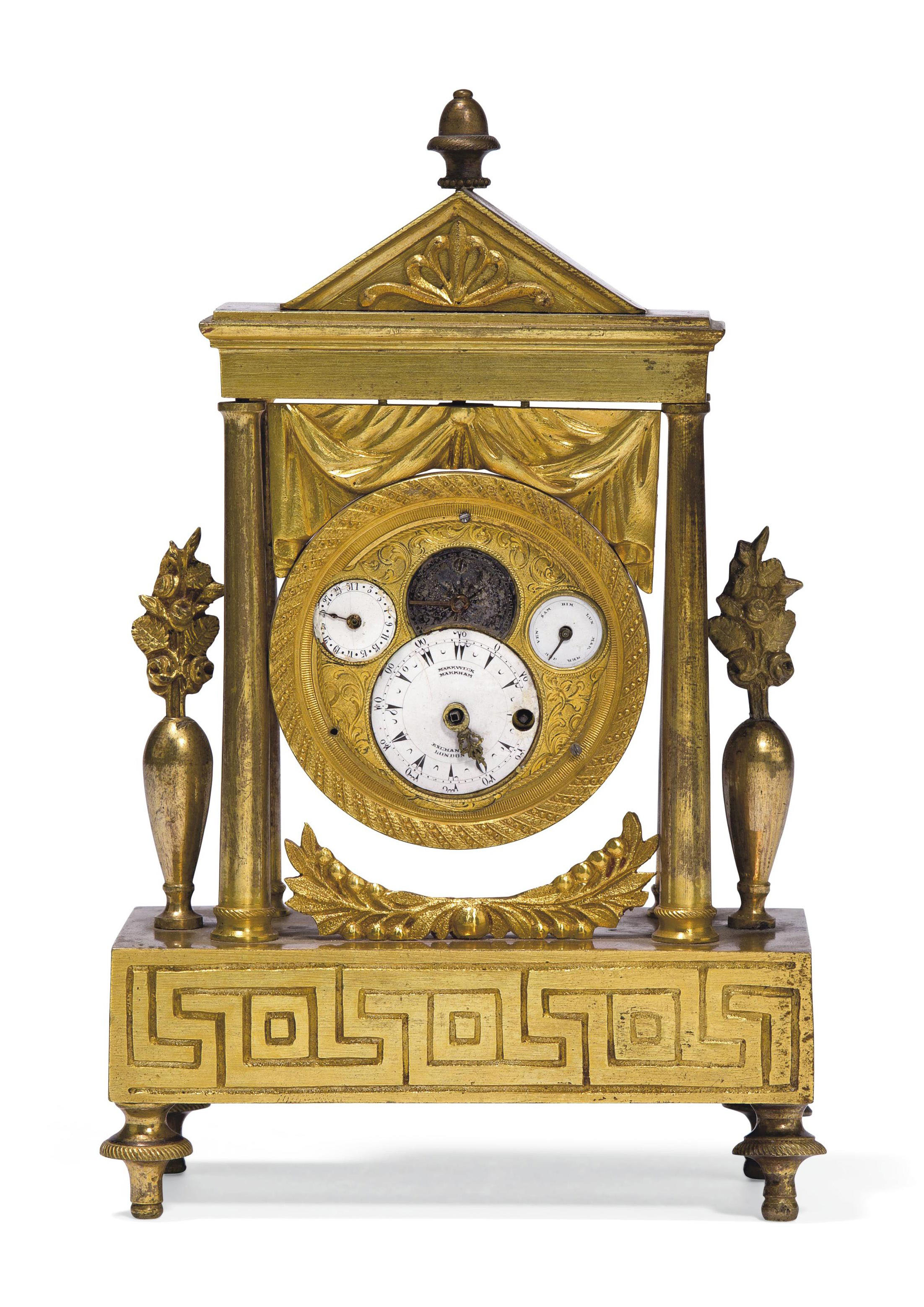 A SMALL ORMOLU TIMEPIECE TABLE CLOCK MADE FOR THE TURKISH MARKET