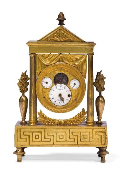 A SMALL ORMOLU TIMEPIECE TABLE