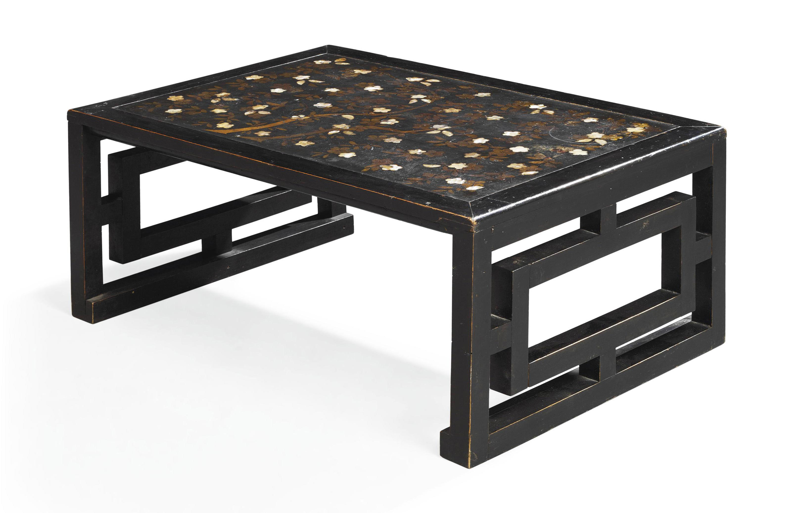 AN EBONISED LOW TABLE INCORPOR