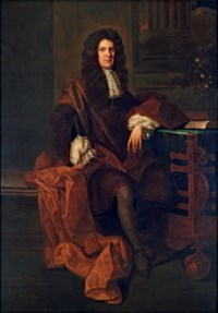 Portrait of a gentleman, traditionally identified as John Sheffield, 1st Duke of Buckingham and Normanby (1647-1721), full-length, in a dark coat with a brown mantle, seated by a table