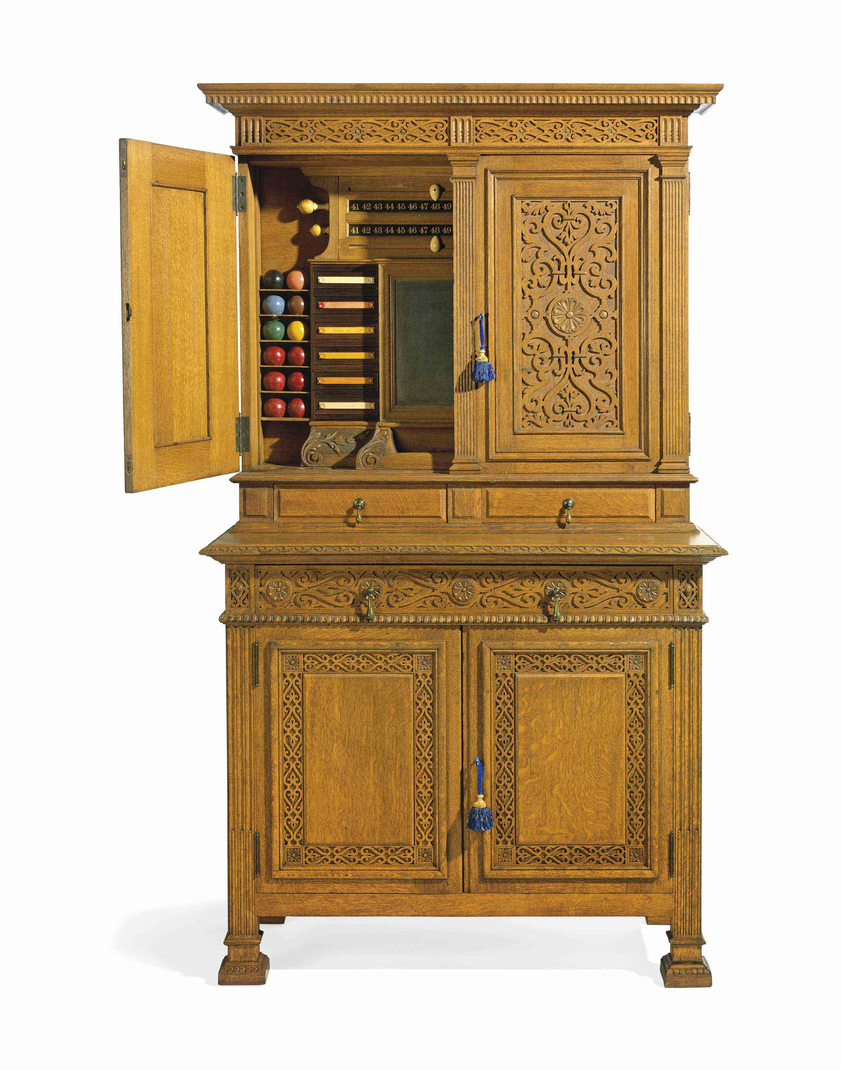 AN ELIZABETHAN REVIVAL OAK AND IVORY INLAID BILLIARDS CABINET
