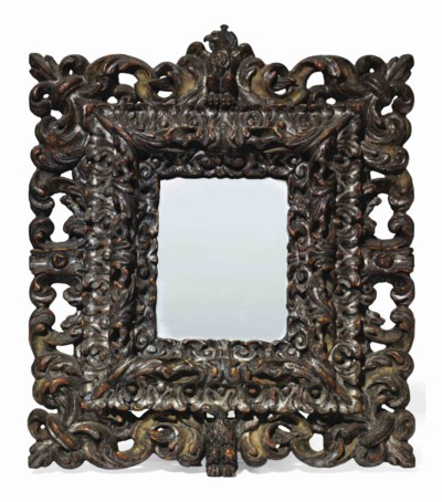 A SILVERED PICTURE FRAME MIRRO
