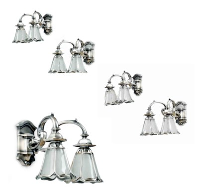 A SET OF FIVE SILVERED METAL T