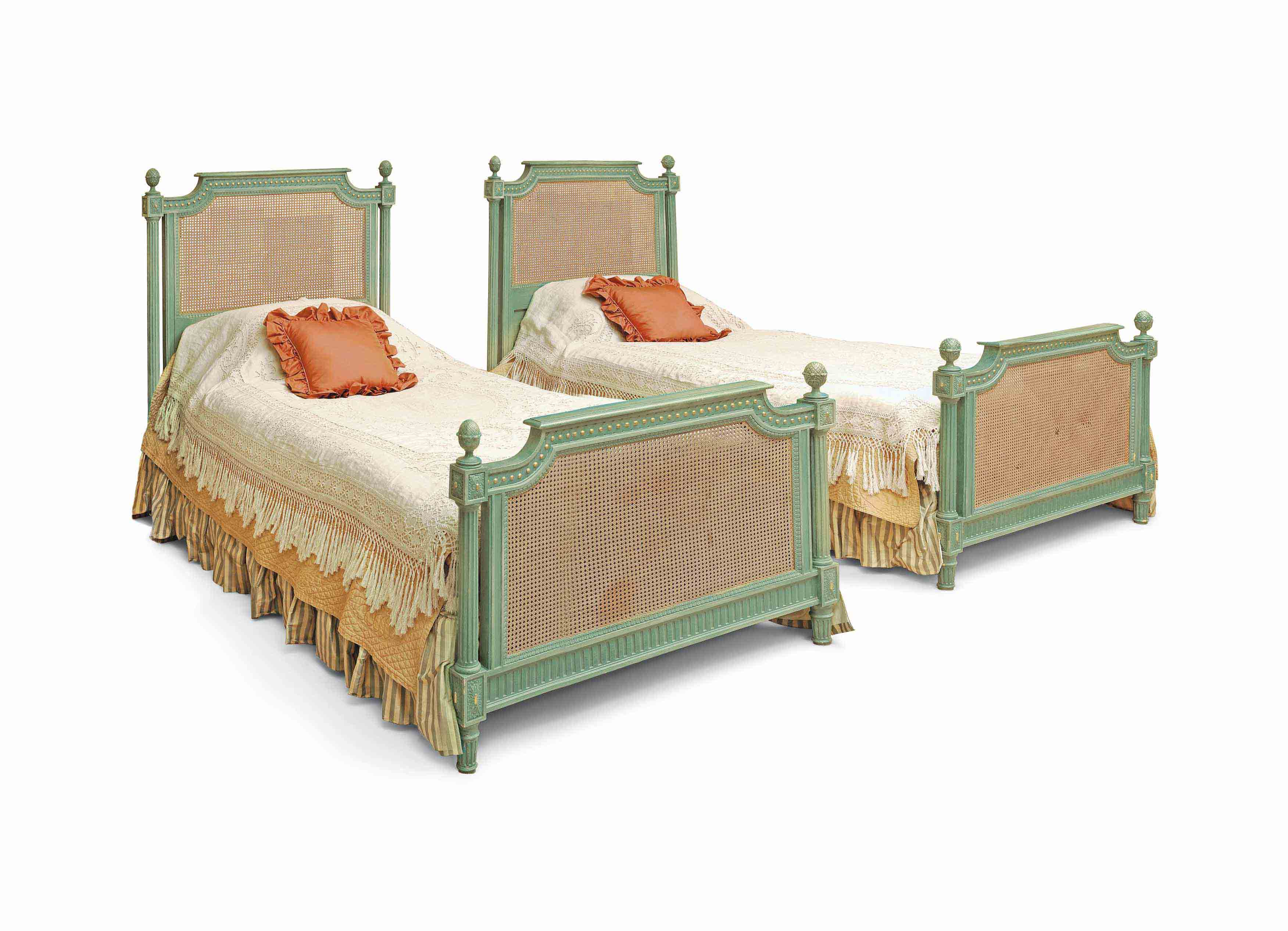 A PAIR OF GREEN-PAINTED AND PARCEL-GILT SINGLE BEDS