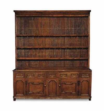 AN ENGLISH OAK DRESSER AND PLA