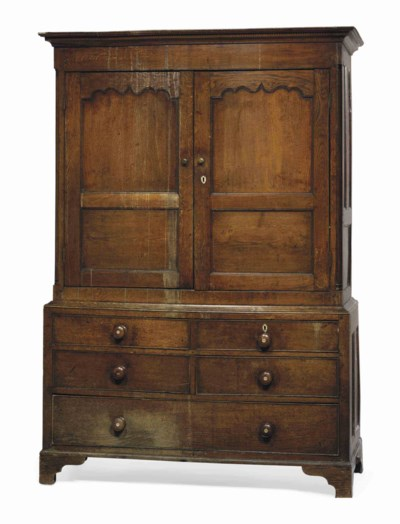 A LATE GEORGE III OAK CUPBOARD