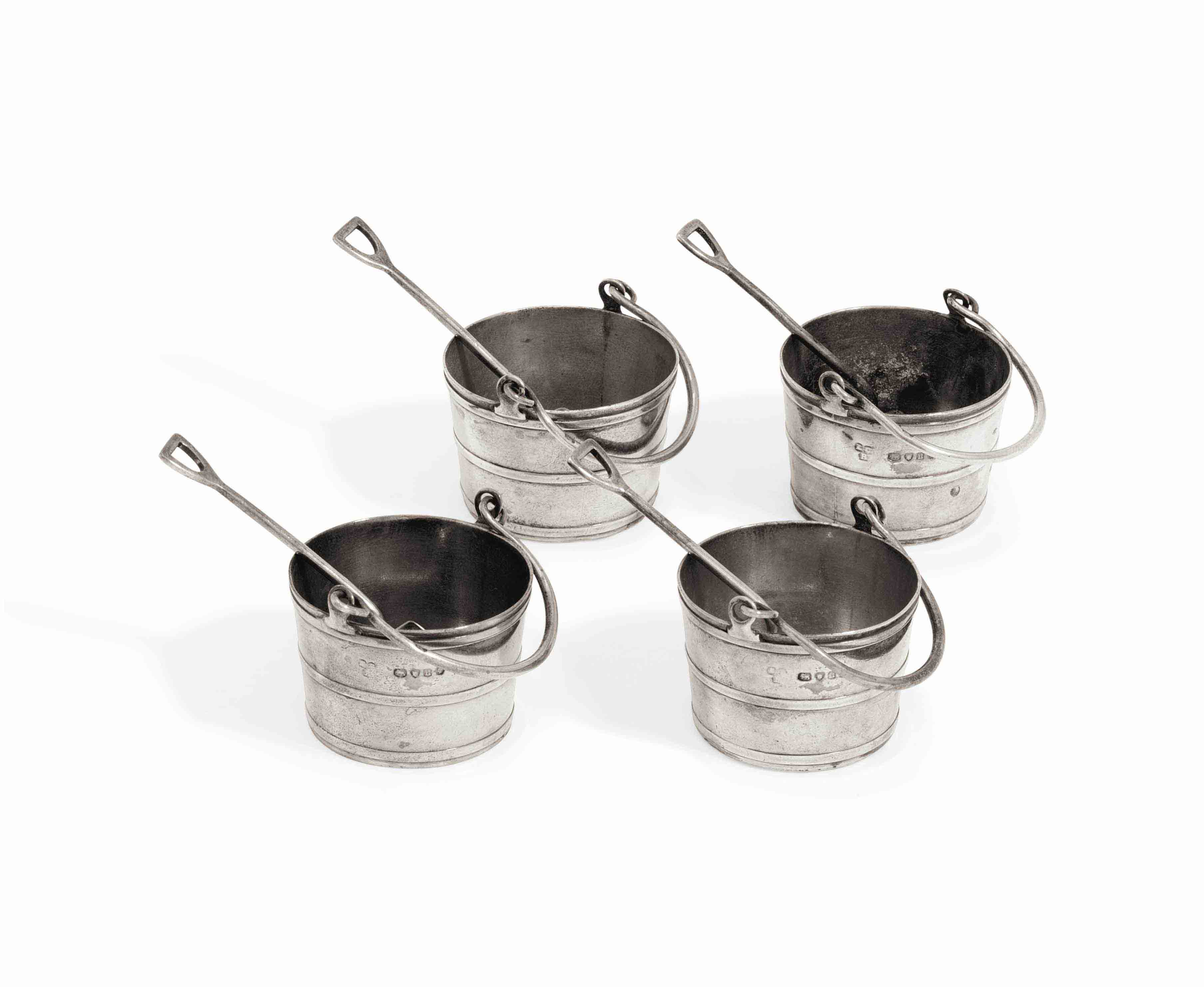 A SET OF FOUR VICTORIAN SILVER SALT-CELLARS AND SPOONS
