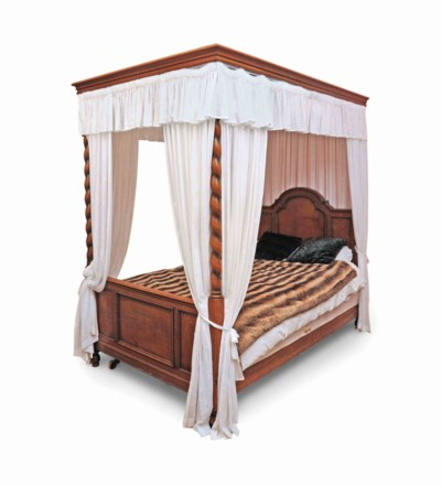 AN ENGLISH OAK FOUR-POSTER BED