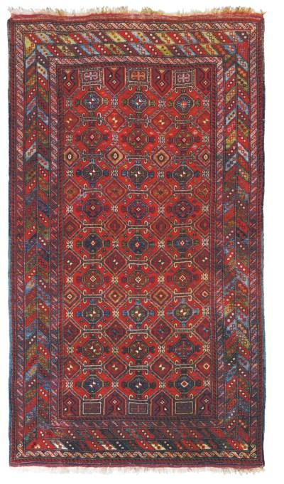 A WEST PERSIAN RUG OF TURKMEN