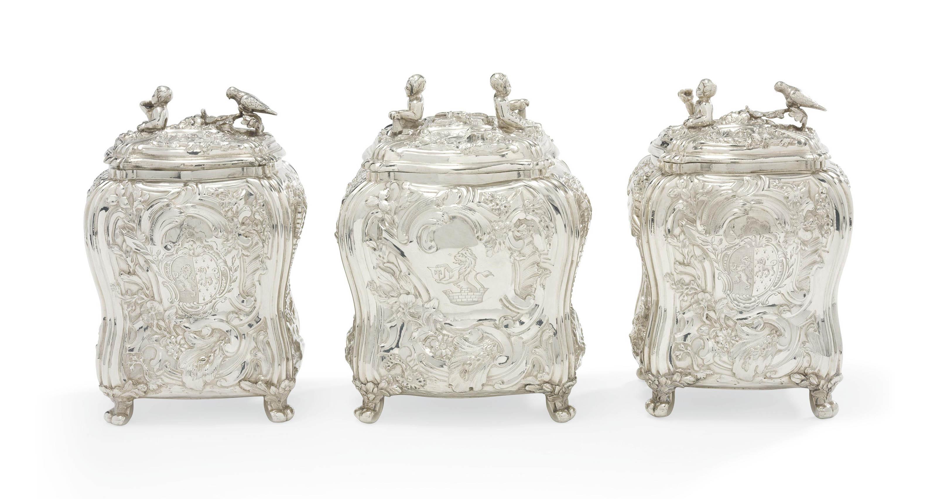 A PAIR OF GEORGE II SILVER TEA-CADDIES AND A SUGAR-BOX EN-SUITE