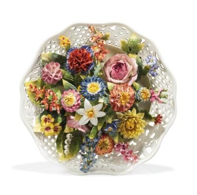 A GERMAN PORCELAIN FLOWER-ENCR