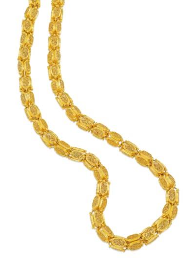 AN ANTIQUE GOLD LONGCHAIN