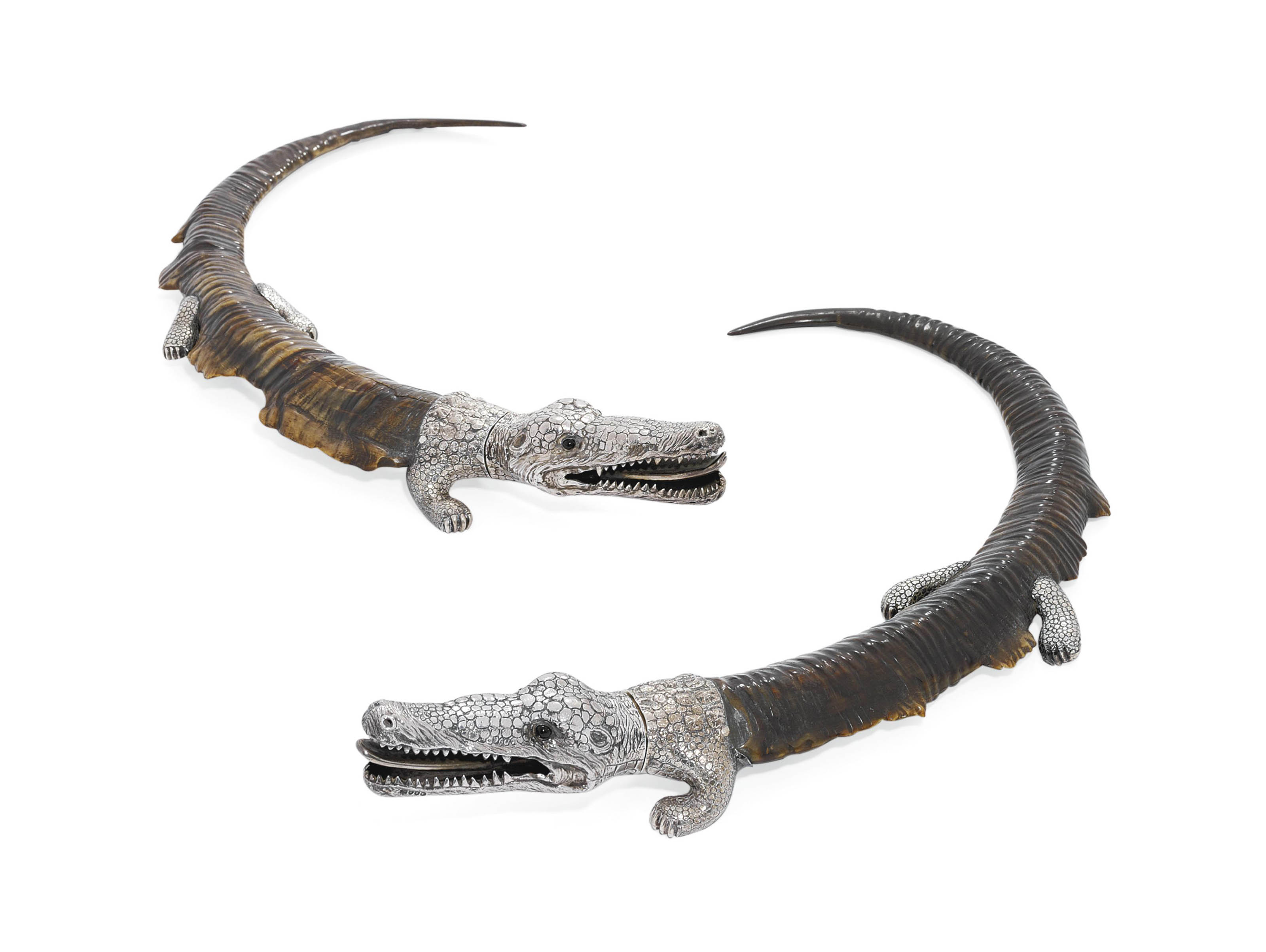 A PAIR OF VICTORIAN SILVER-MOUNTED IBEX-HORN SMOKER'S COMPANIONS