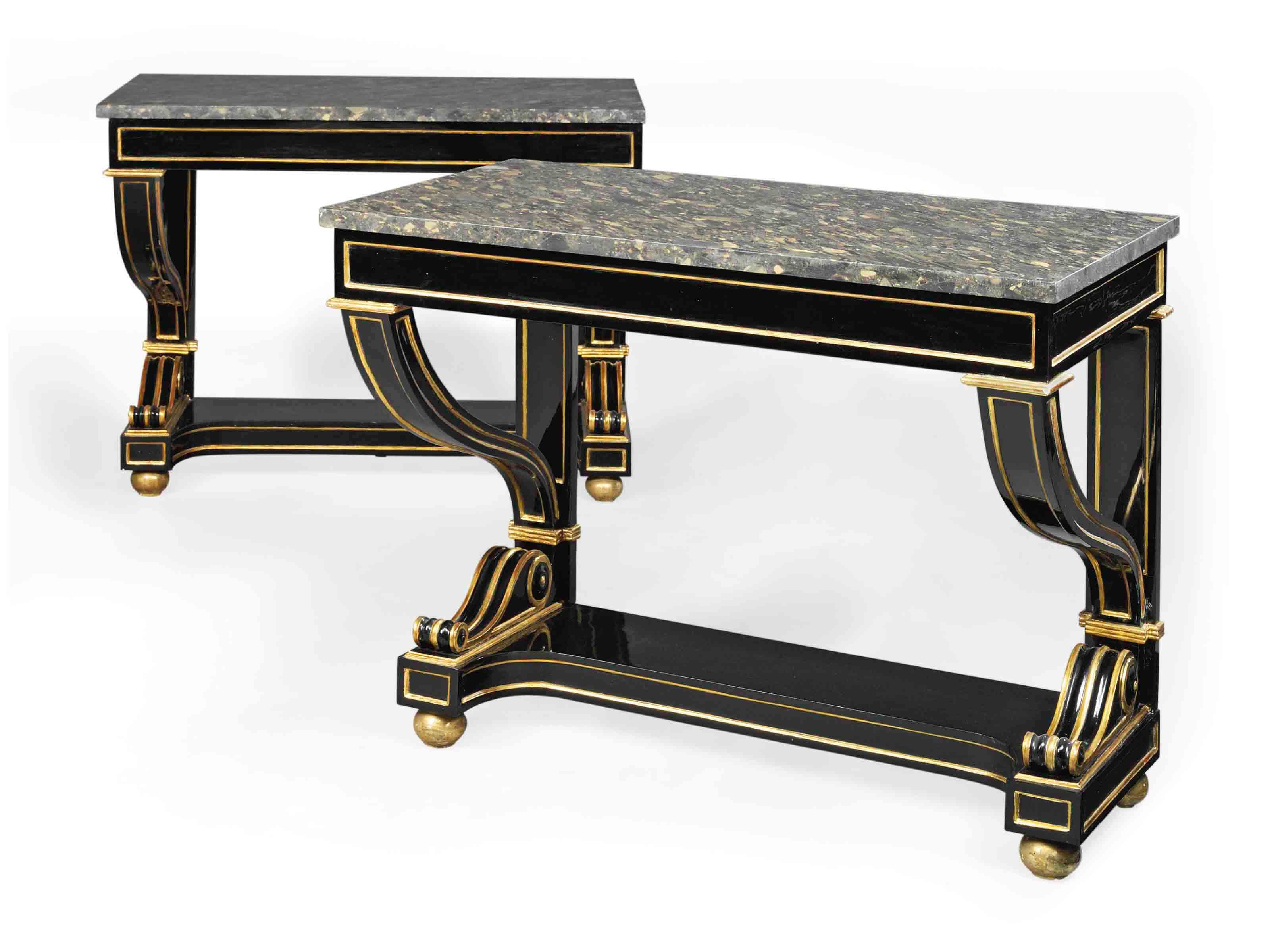 A PAIR OF ITALIAN PARCEL-GILT AND EBONIZED CONSOLE TABLES