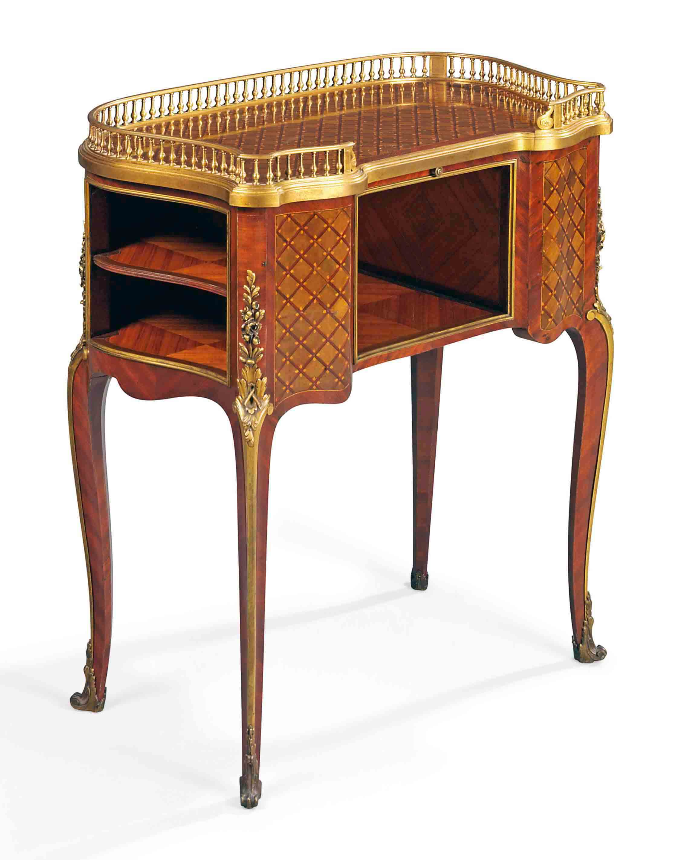 A FRENCH ORMOLU-MOUNTED AMARANTH AND HAREWOOD PARQUETRY TABLE DE TOILETTE