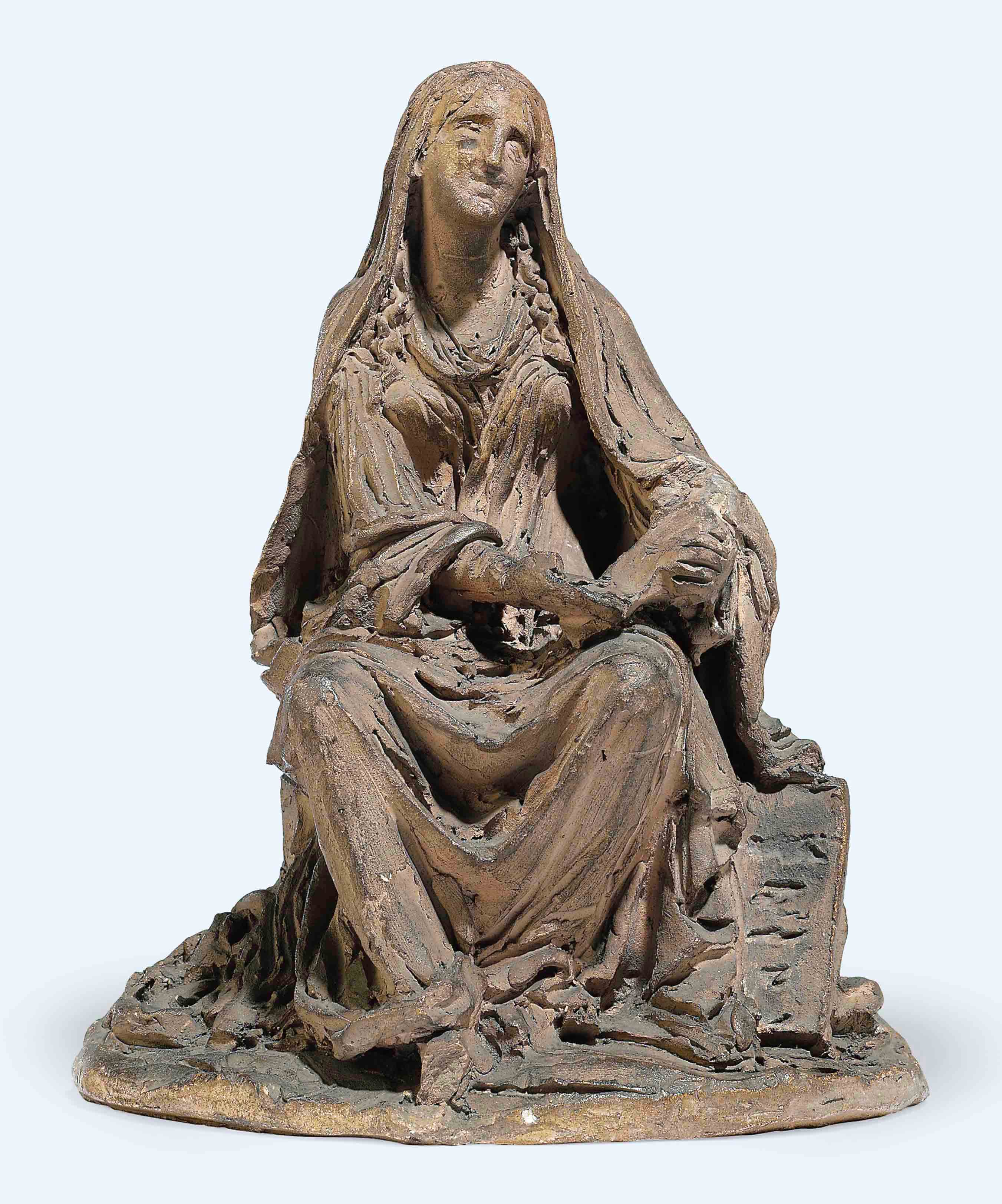 A FRENCH TERRACOTTA MAQUETTE OF A SEATED FEMALE FIGURE