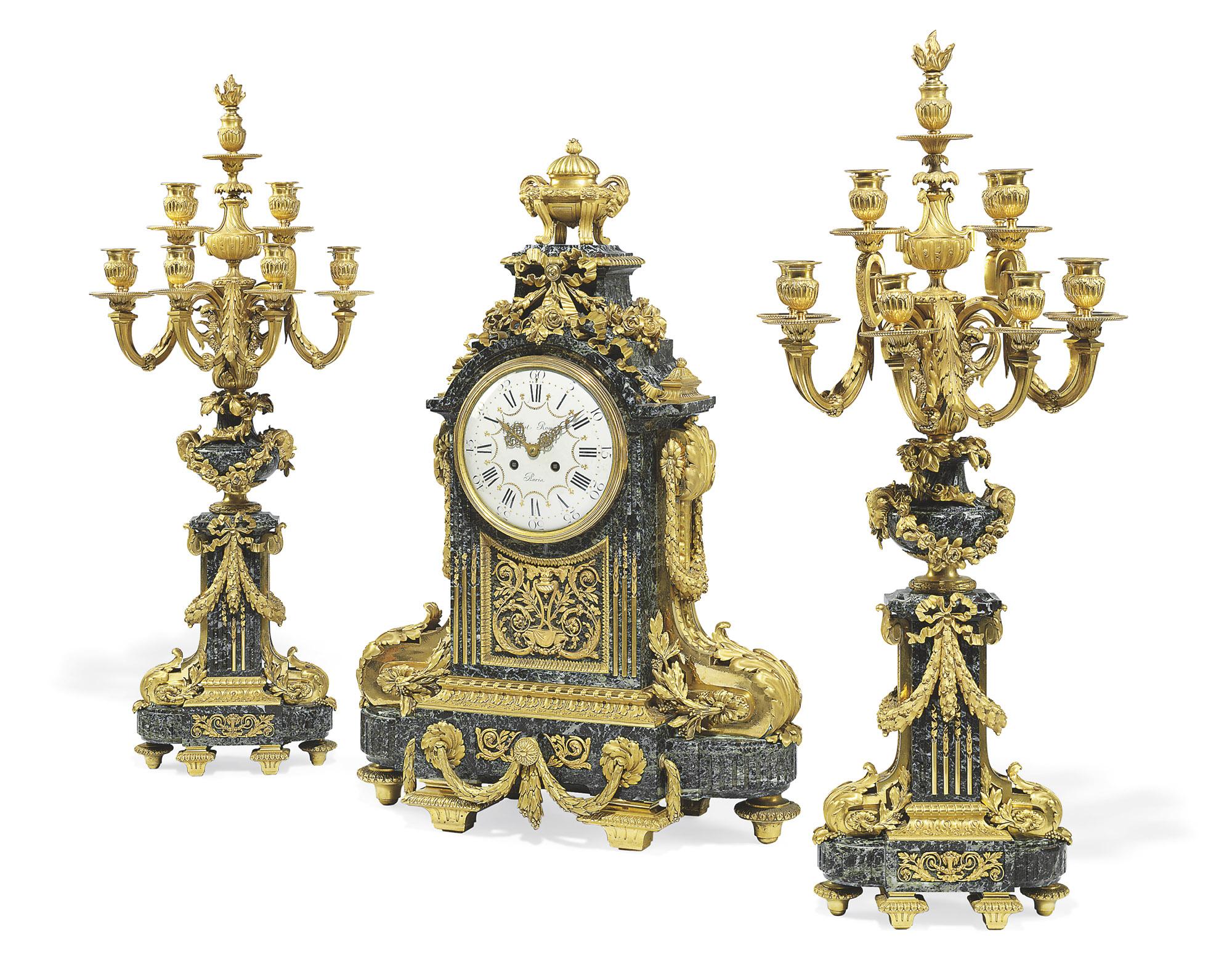 A LARGE NAPOLEON III ORMOLU AND MARBLE THREE-PIECE CLOCK GARNITURE