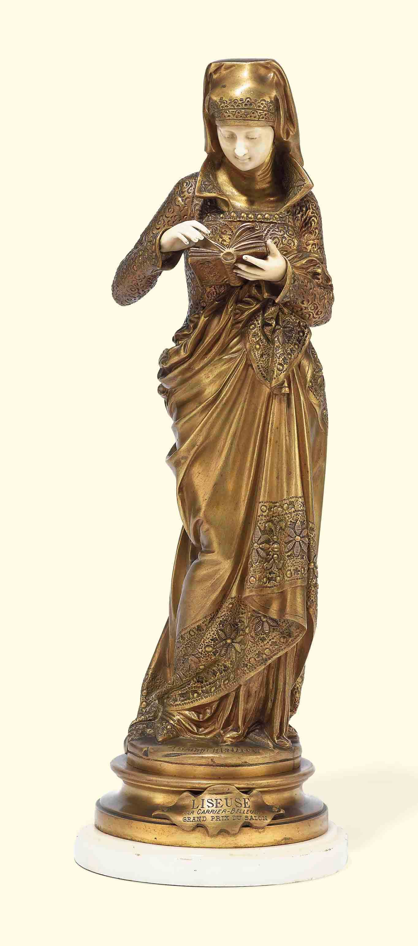A FRENCH GILT-BRONZE AND IVORY FIGURE ENTITLED 'LISEUSE'