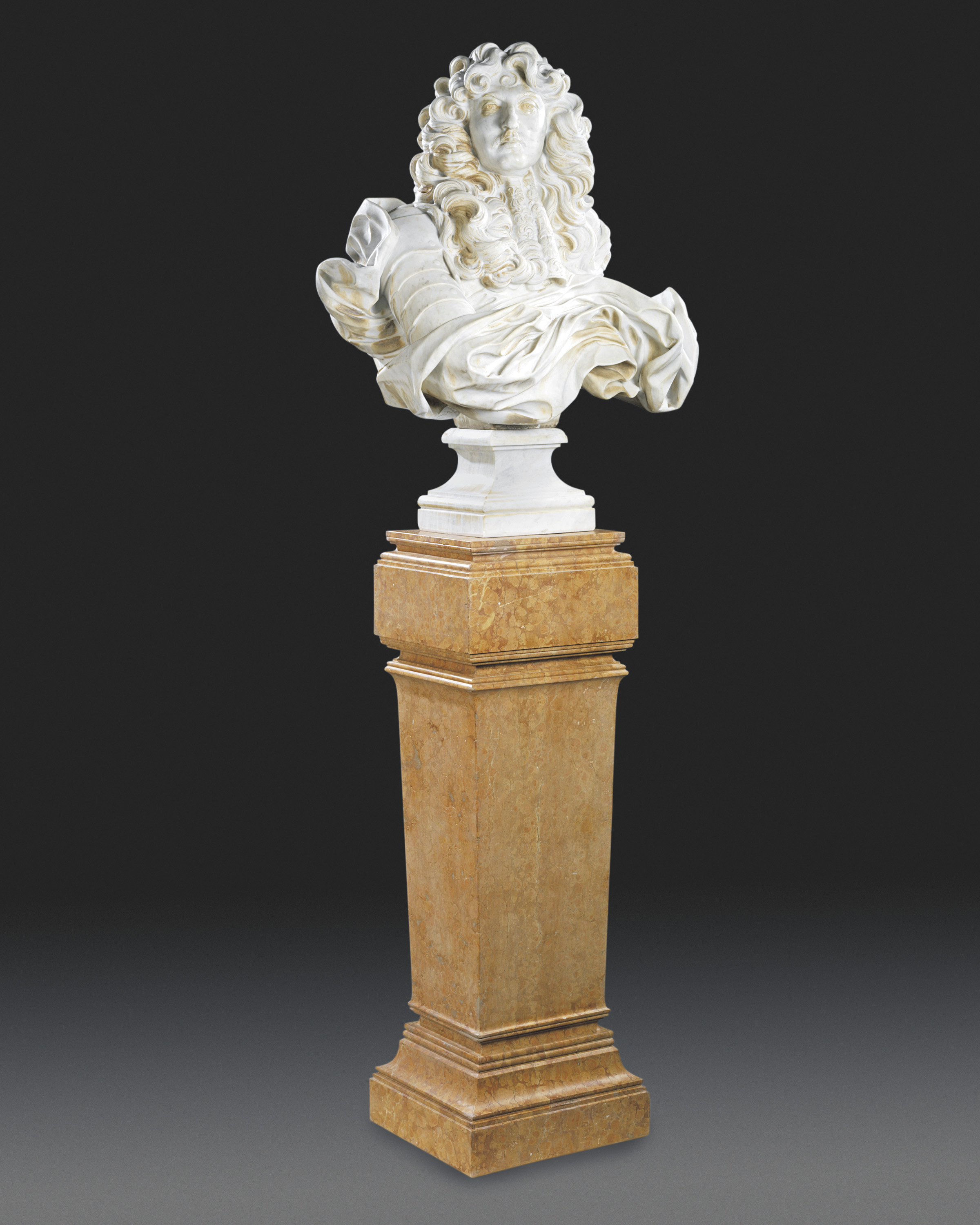 A FRENCH/ITALIAN OVER-LIFE-SIZE MARBLE BUST OF LOUIS XIV