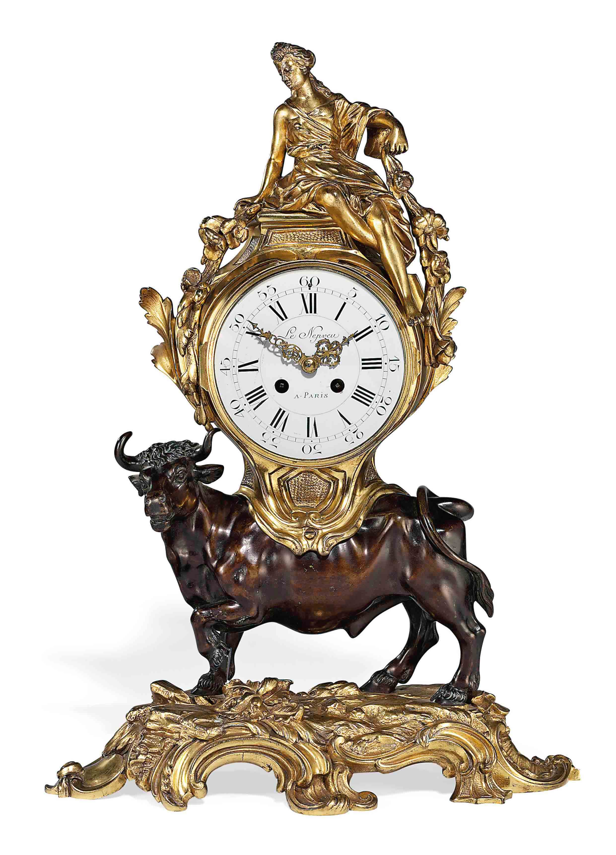 A LOUIS XV STYLE PATINATED AND GILT BRONZE STRIKING MANTEL CLOCK: 'EUROPA AND THE BULL'