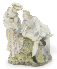 A CAPODIMONTE (CARLO III) GROUP OF A COUPLE WITH A DOG