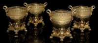 THE FOLEY WINE COOLERS A SET OF FOUR GEORGE III SILVER-GILT WINE-COOLERS, COLLARS AND LINERS IN THE EGYPTIAN STYLE