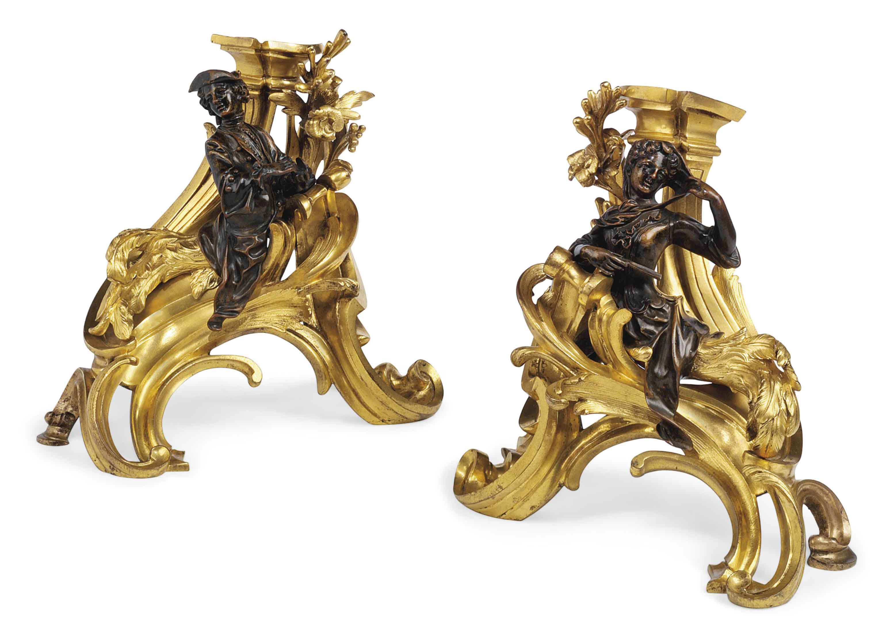 A PAIR OF FRENCH PATINATED BRONZE AND ORMOLU CHENETS