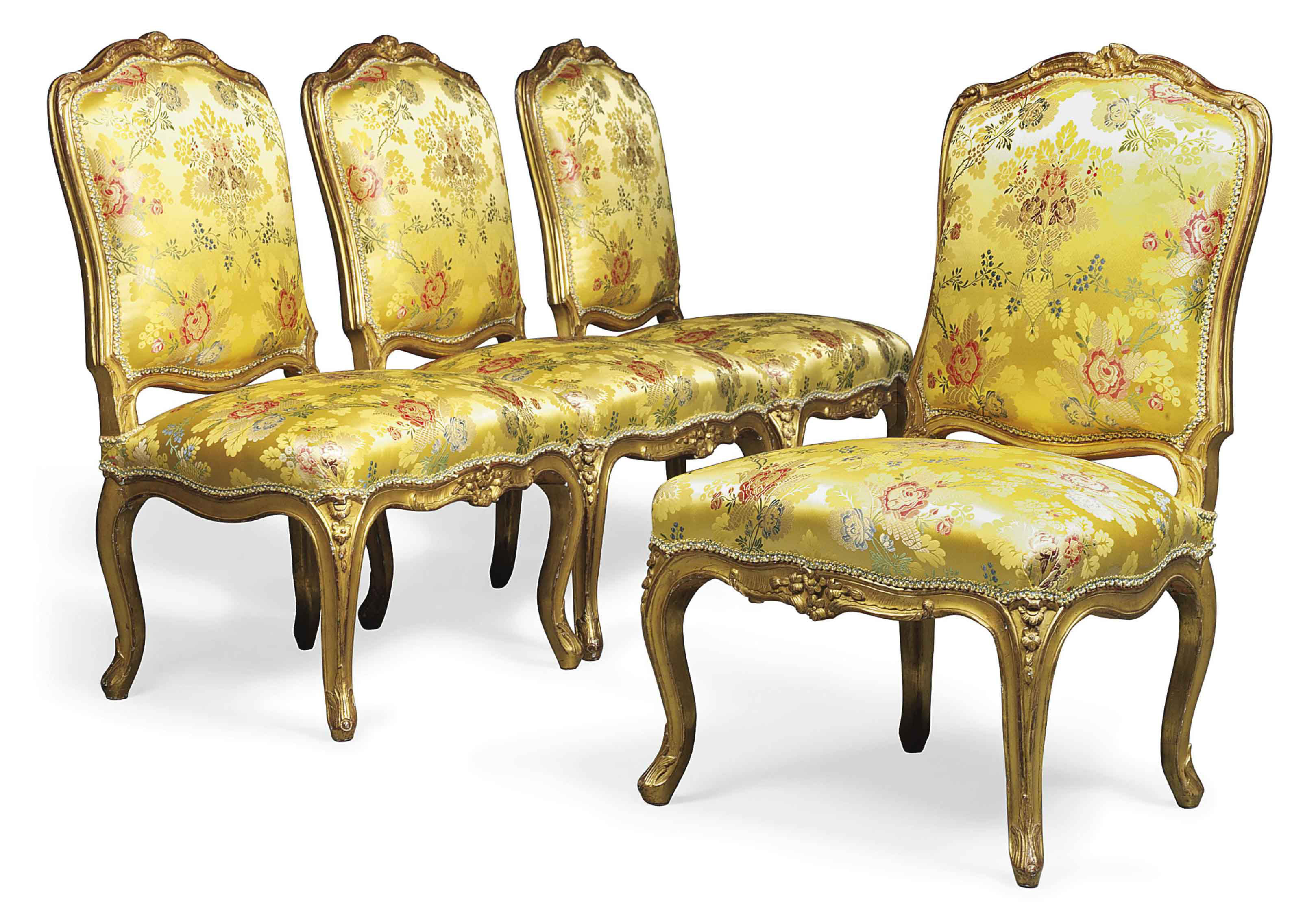 A SET OF FOUR LOUIS XV GILTWOOD CHAISES