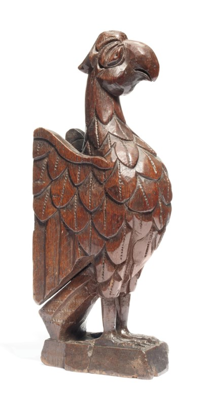 AN ENGLISH CARVED OAK FINIAL