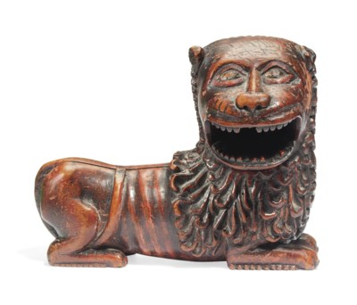 A POLYCHROME CARVED WOOD LION