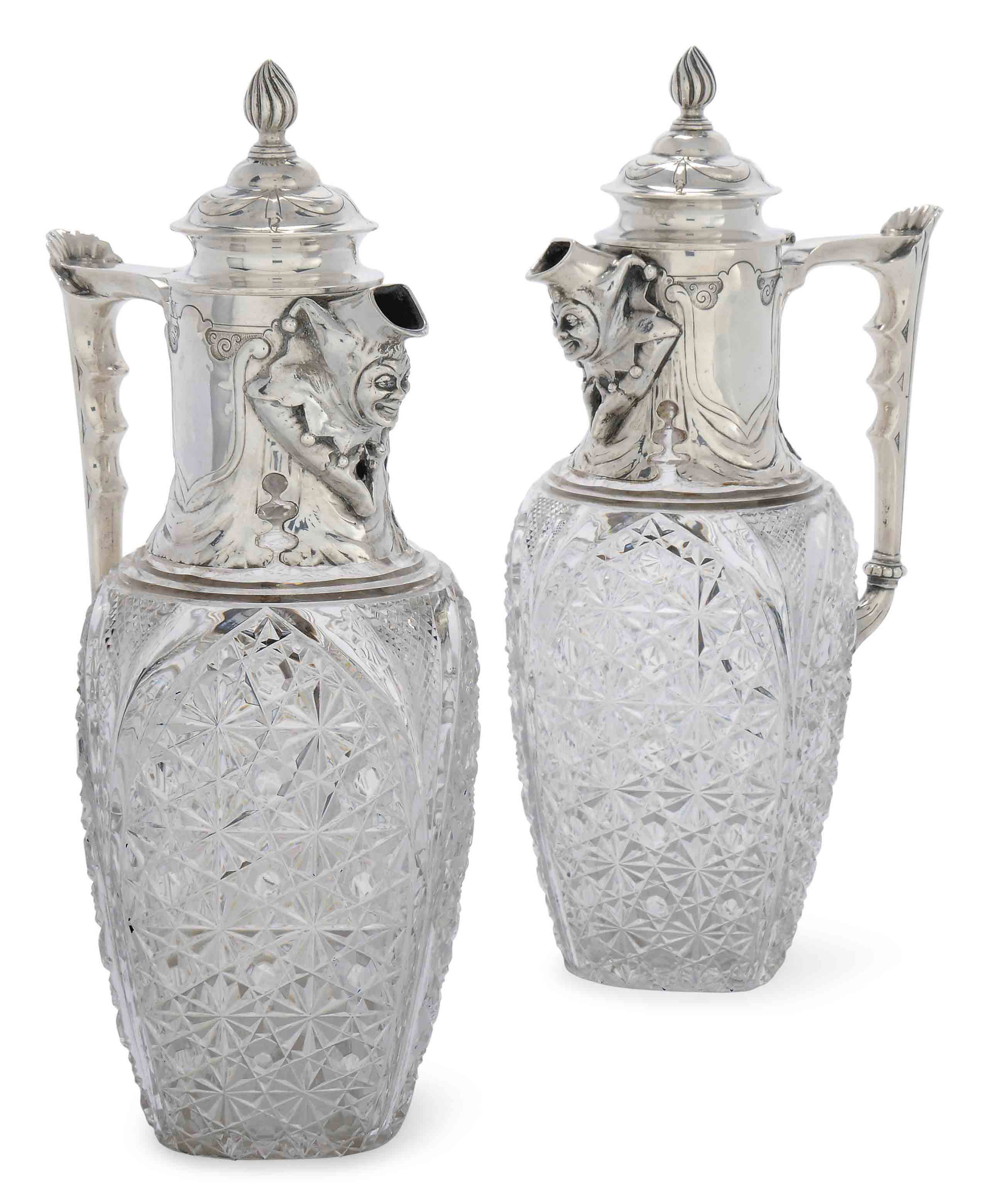 A PAIR OF LATE VICTORIAN SILVER-MOUNTED CUT-GLASS CLARET JUGS