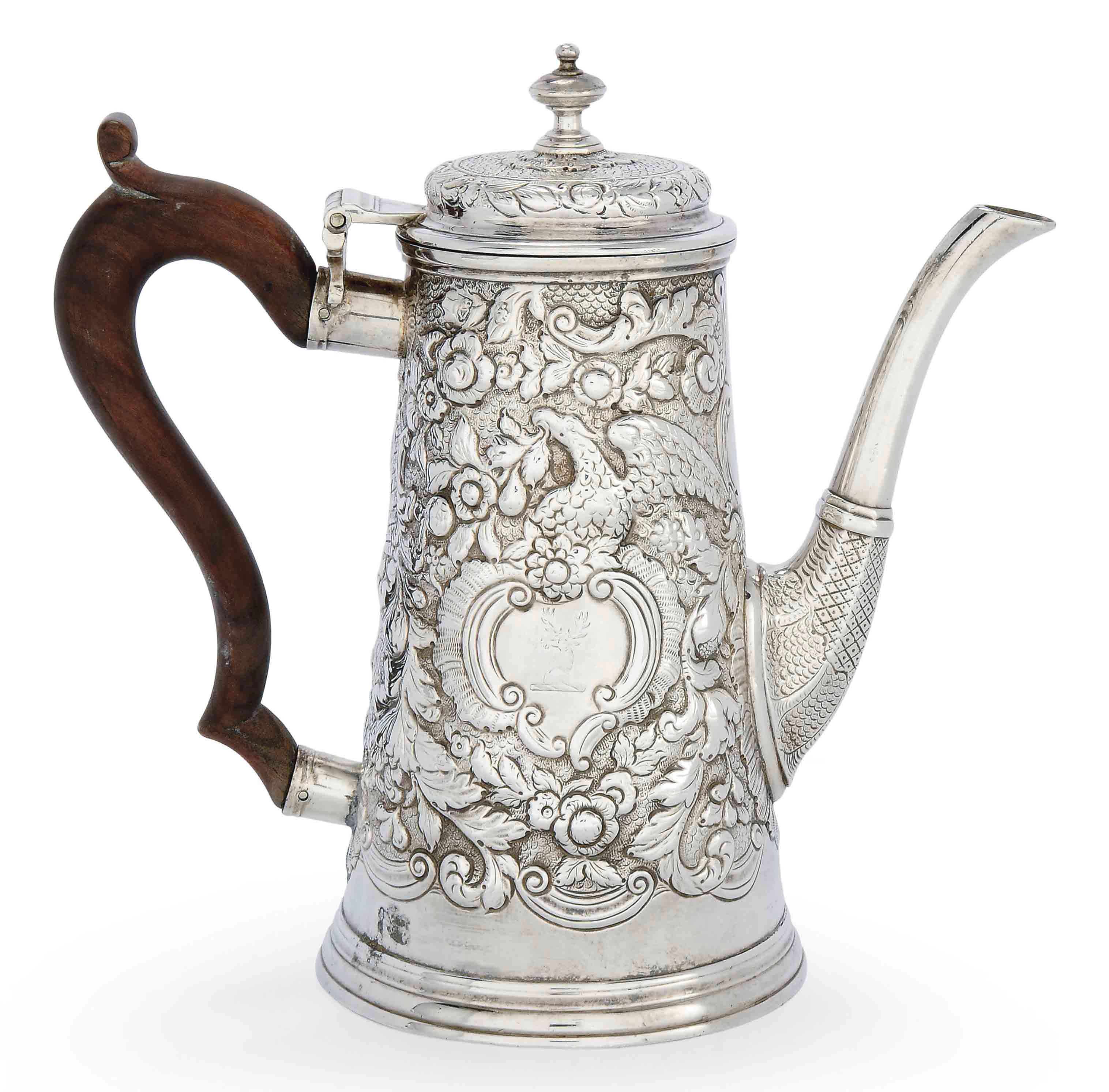 A GEORGE II IRISH SILVER COFFEE POT
