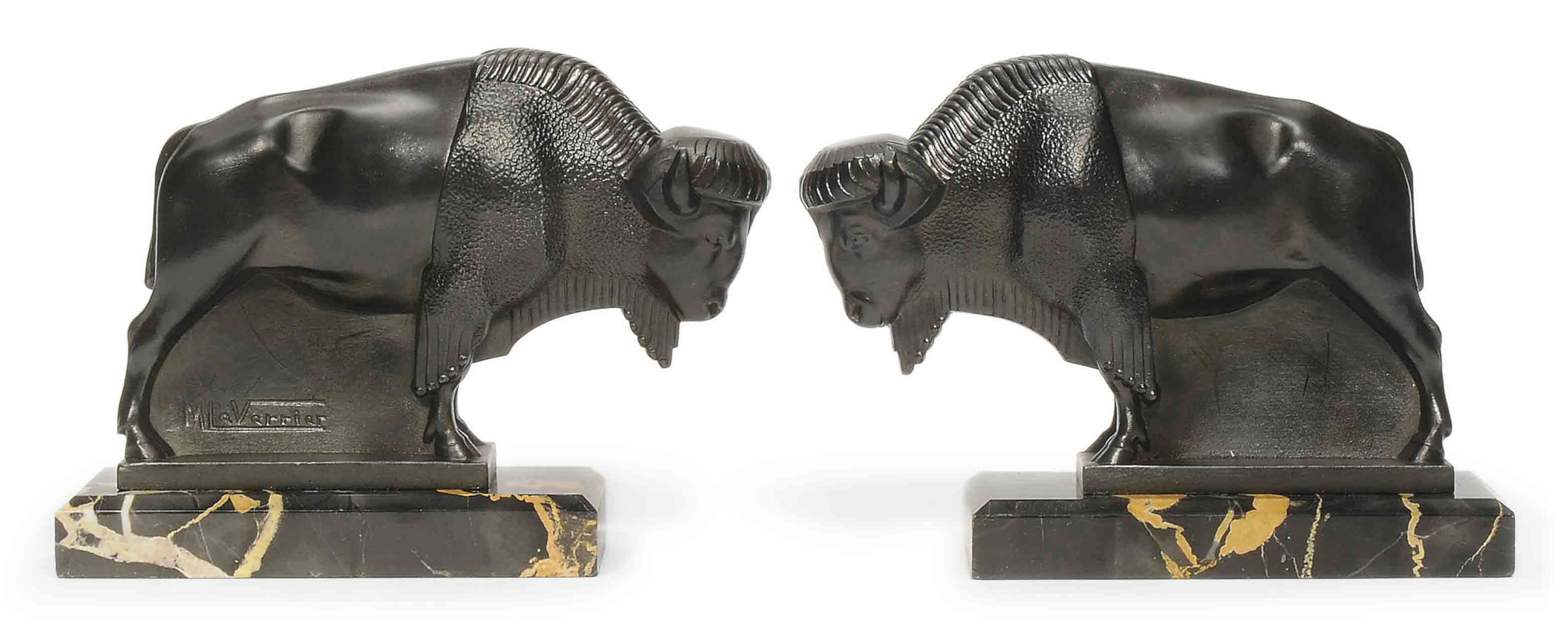 A PAIR OF MAX LE VERRIER COLD-PAINTED METAL 'BISON' BOOKENDS