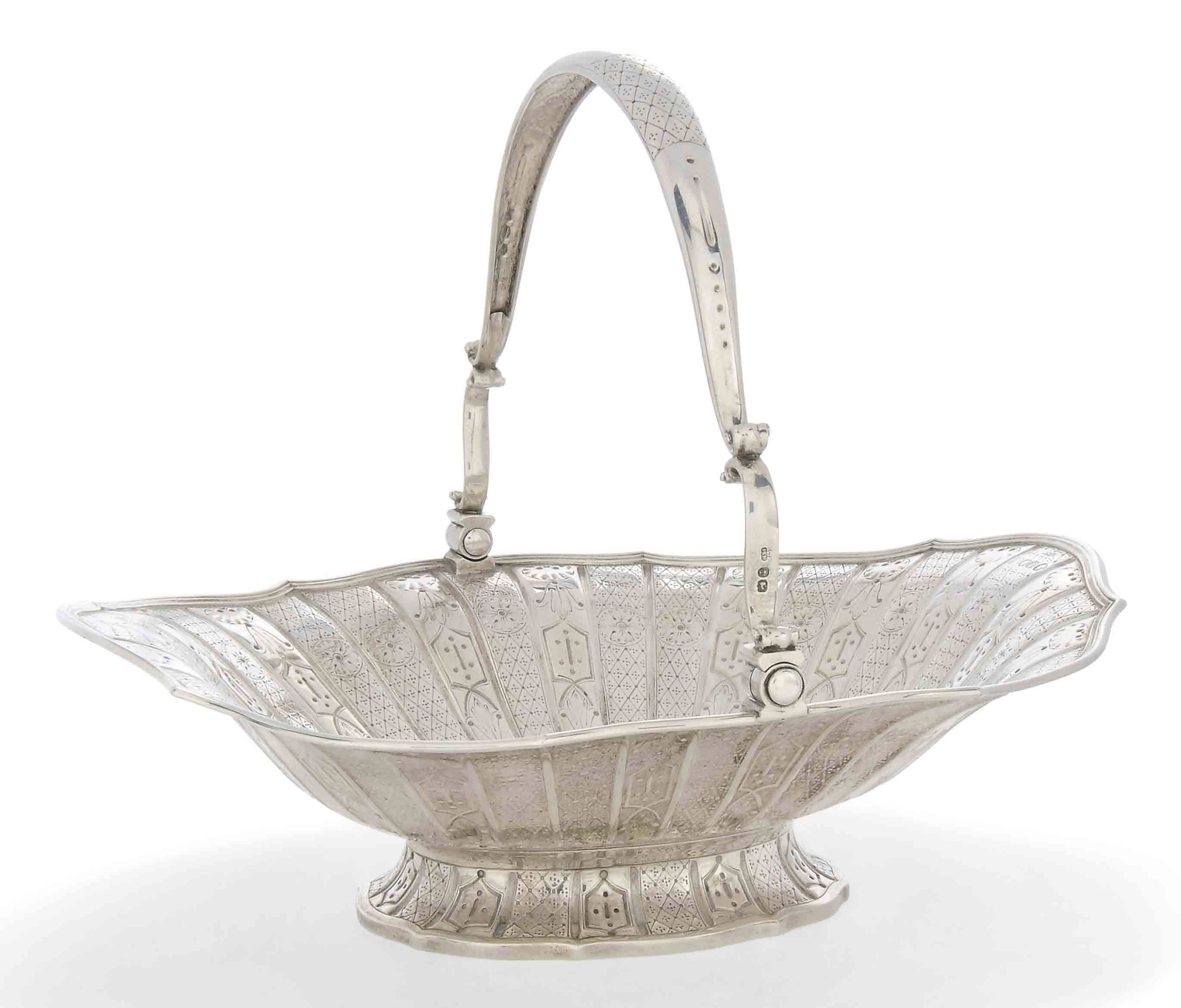 A VICTORIAN SILVER SWING-HANDL