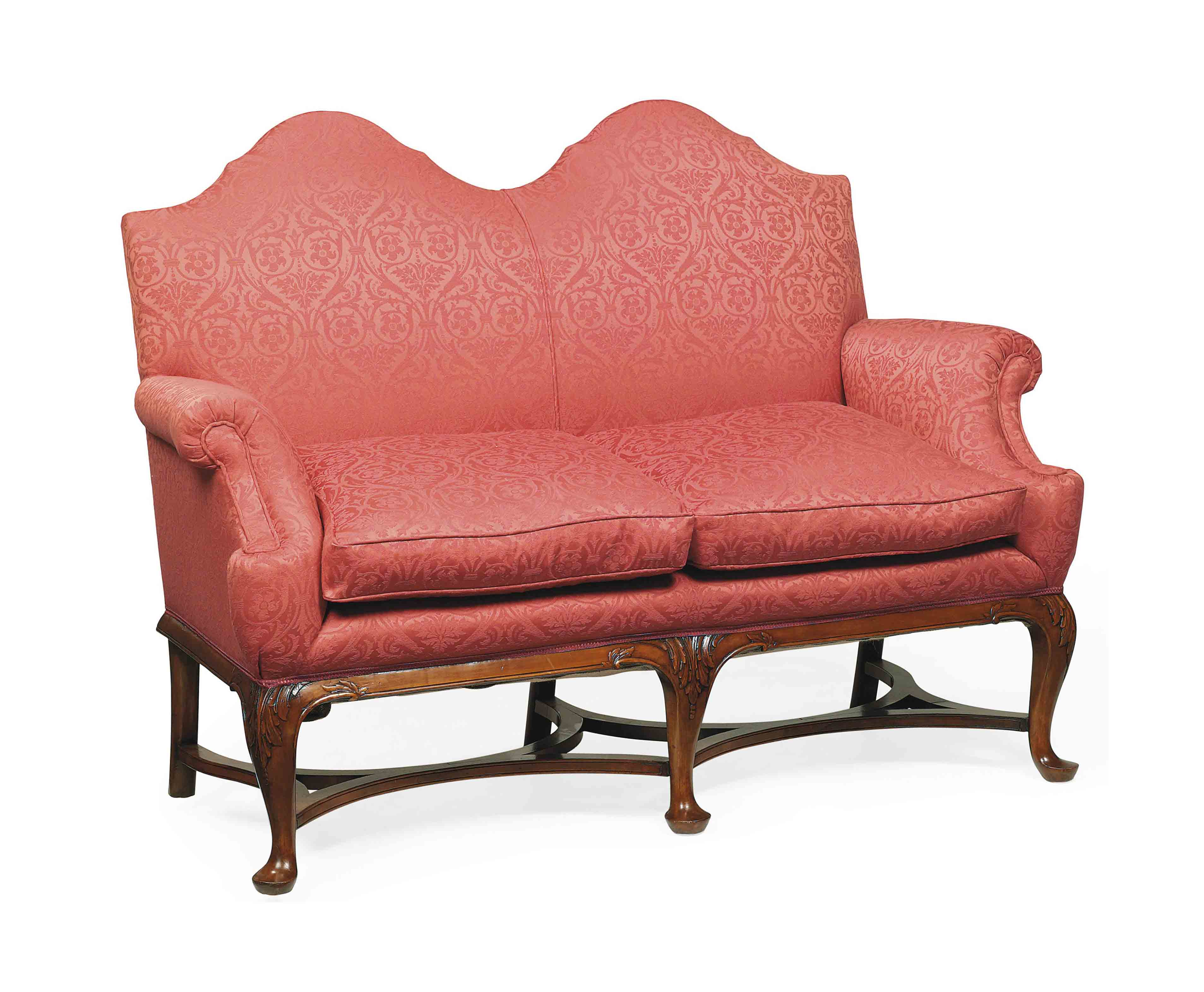 A Carved Walnut Settee Of Queen Anne