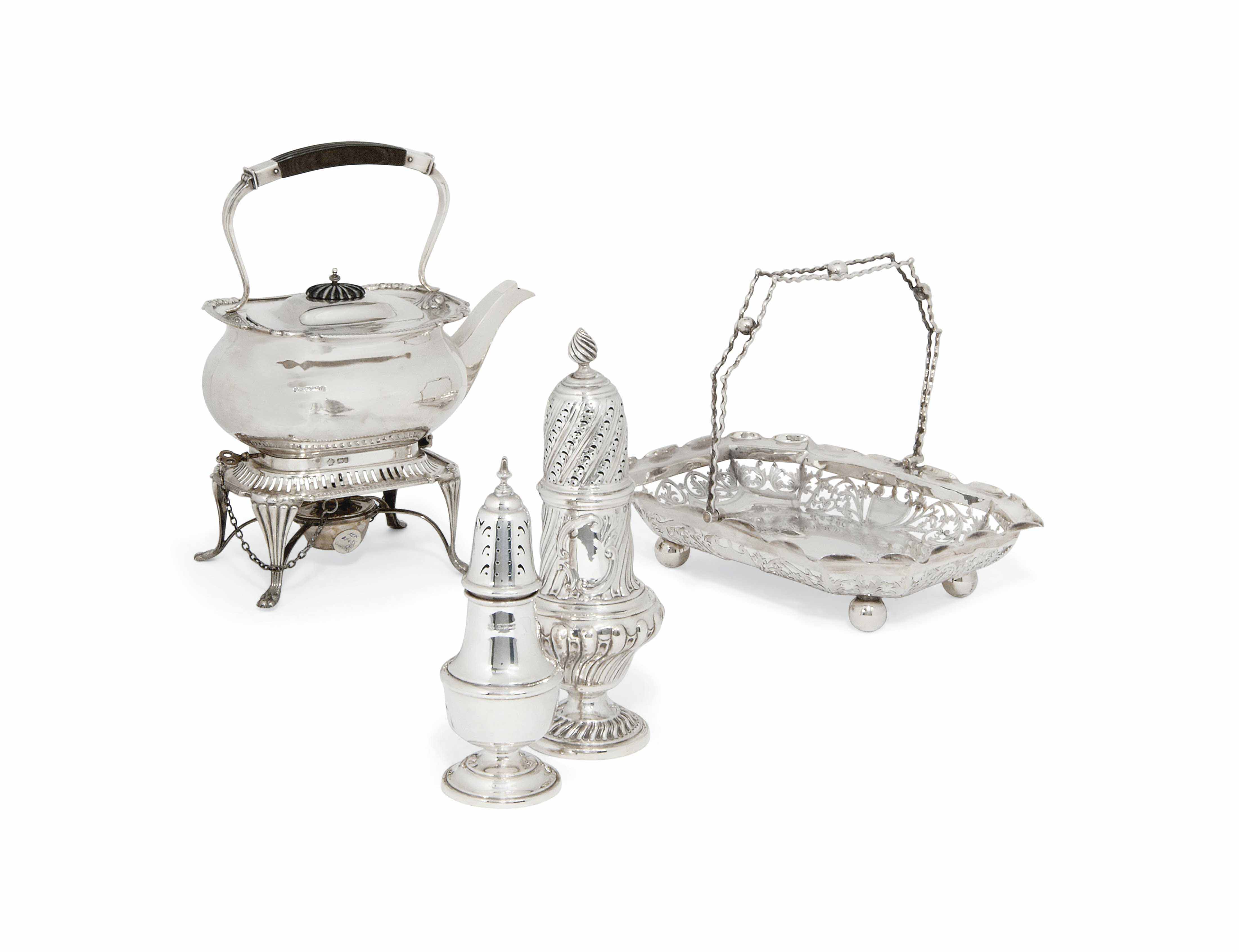 AN EDWARDIAN SILVER KETTLE ON STAND