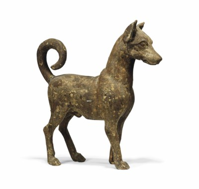 A CARVED WOOD FIGURE OF A DOG