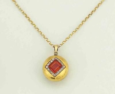 A garnet and diamond pendant n
