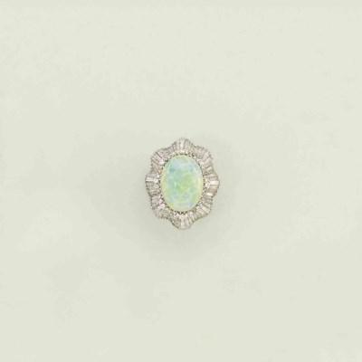 An opal and diamond ring/penda