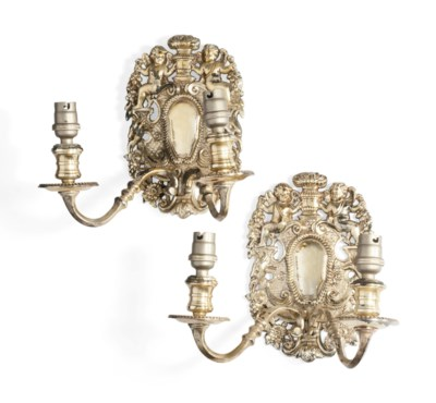 A SET OF FOUR PLATED BRASS TWI