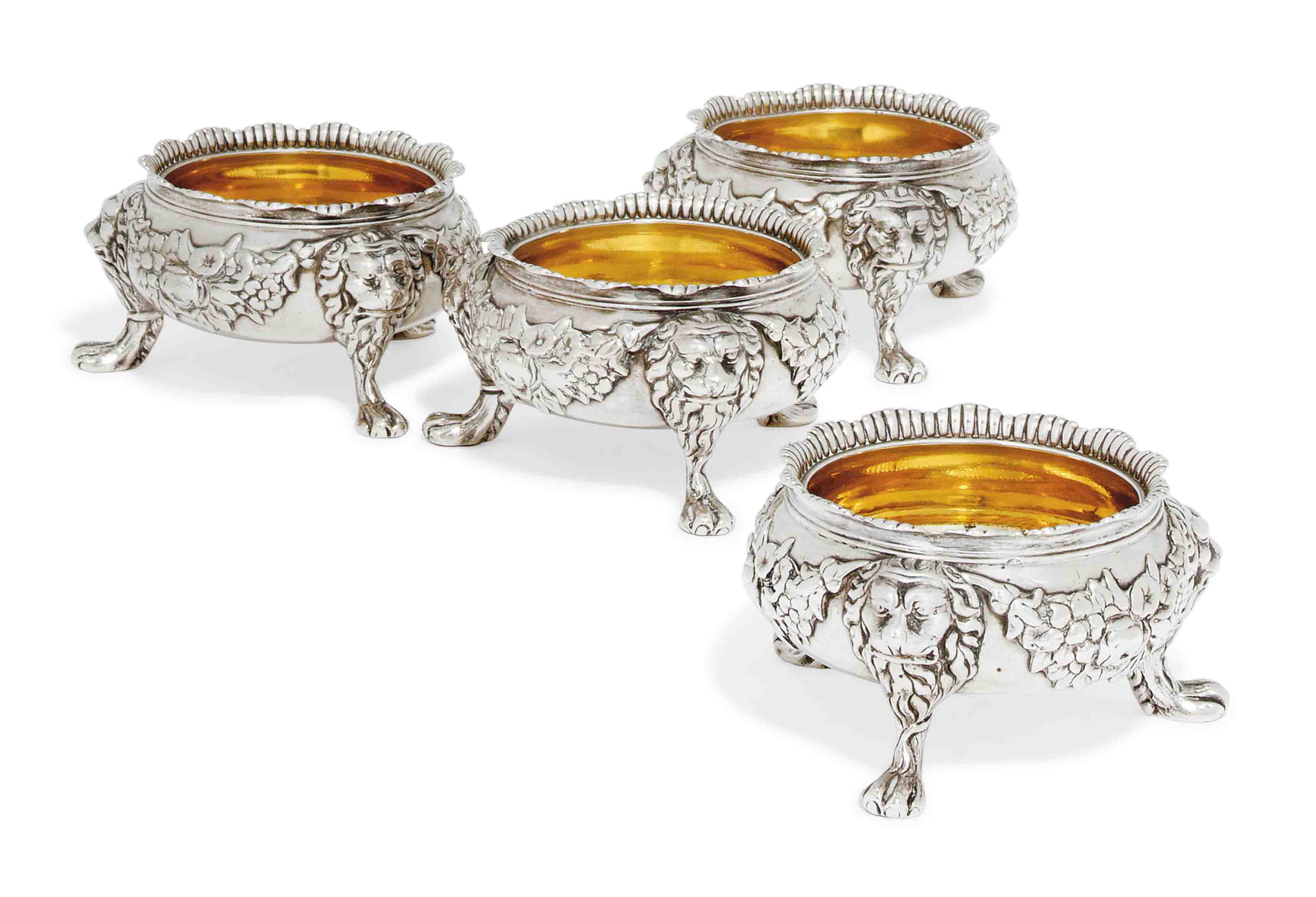 A SET OF FOUR GEORGE II CIRCULAR SILVER SALTS