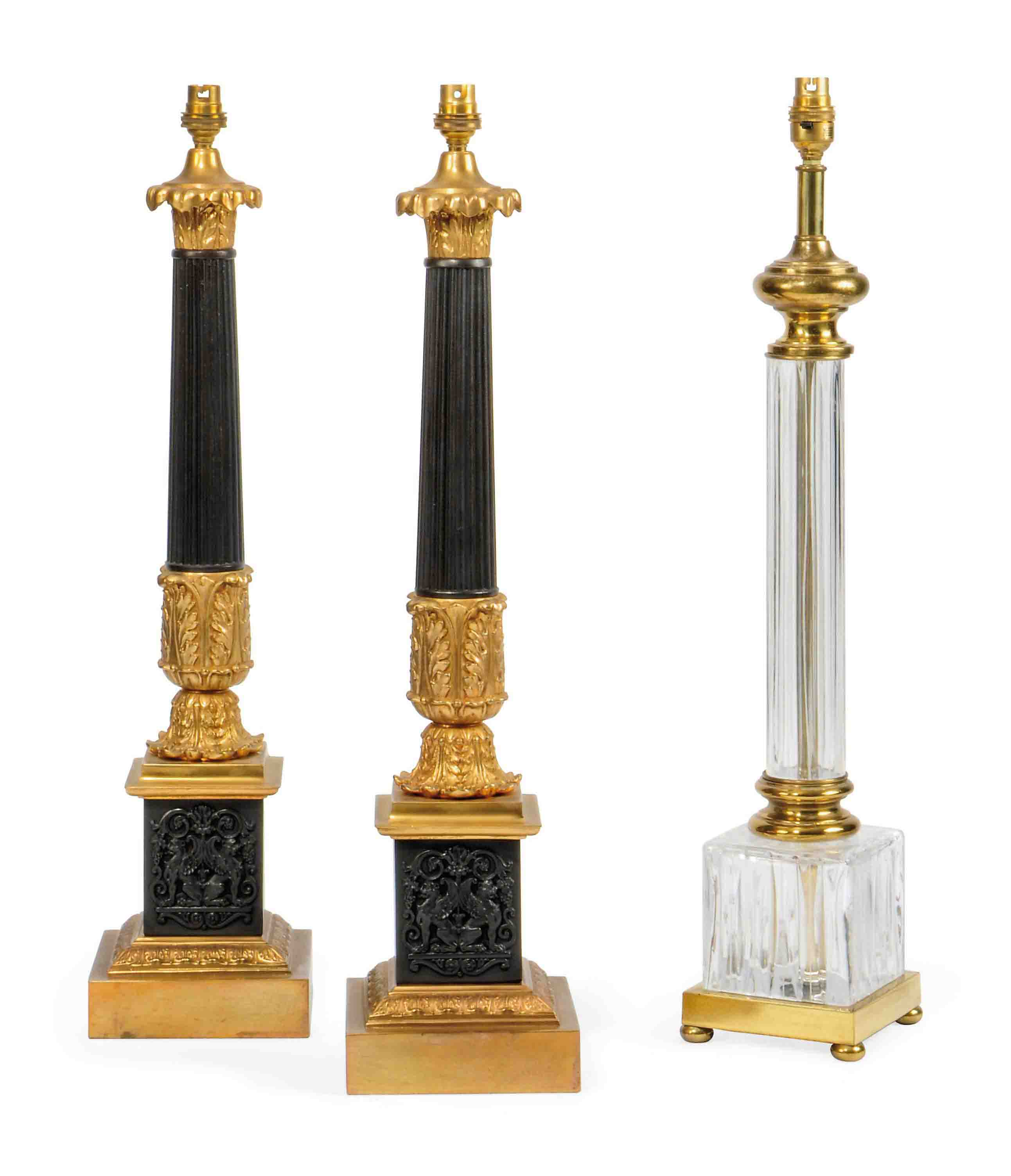 A PAIR OF GILT BRASS AND PATINATED TABLE LAMPS